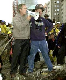 Bush with firefighter.
