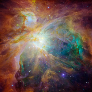Hubble and Spitzer Space Telescopes image of the Orion Nebula.