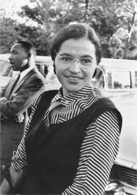 Rosa Lee Parks in 1955 with MLK in the background.